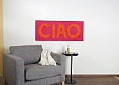 DIY fabric wall hanging with lettering spelling 'Ciao'