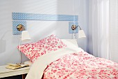 DIY bed headboard made from MDF panels covered in blue and white polka-dot fabric
