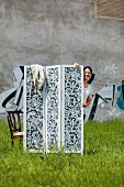 Screen hand made from black and white patterned fabric