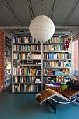 Metal bookcases in industrial loft apartment