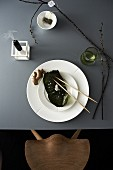 Japanese place setting with sheet of nori, ginger root and chopsticks