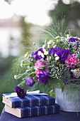 Bouquet with purple eustoma on table outdoors