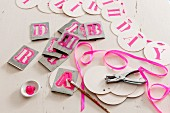Alphabet stencils and letters on garland of card discs for birthday party