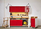 DIY workbench and chest of drawers on castors with red fronts