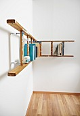 L-shaped bookshelf made from ladders running around corner