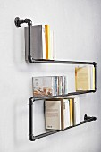 Wall-mounted shelves hand-made from metal pipes