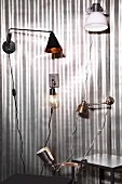 Various wall-mounted lamps and clip lamps on silver background