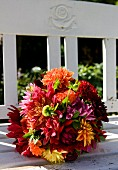 Colourful bouquet of dahlias on bench