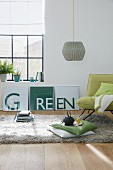 A DIY three-piece with the word 'green' as wall decoration