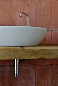 Modern countertop sink on rustic board