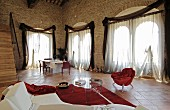 Living-dining room with arched windows in palazzo