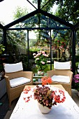 Seating area in conservatory in garden