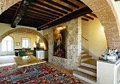 Stone walls and wood-beamed ceiling in Mediterranean living room
