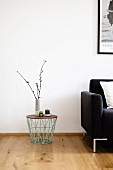 Side table with spindly metal frame