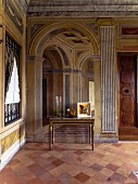 Foyer of palazzo with trompe l'oeil fresco and terracotta floor