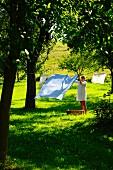Woman hanging up washing in garden
