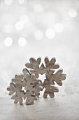 Wooden snowflakes against blurred background