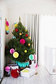 Colorfully decorated Christmas tree with paper balls