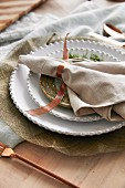 Christmas place setting with cloth napkin and ribbon