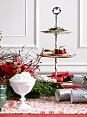 Silver cake stand with strawberry tart on a Christmas decorated table