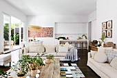 Eclectic living area with upholstered furniture in front of an open patio door