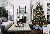 Decorated Christmas tree and wrapped presents in rural living room