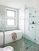 Modern bathroom with free-standing tub, walk-in shower and mosaic tiles