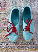 Light blue sneakers with red laces