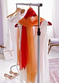 Dyed chiffon scarves draped over a hanger