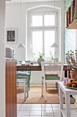 Vintage dining table and chairs in kitchen of period apartment