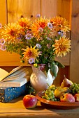 Autumnal bouquet with orange dahlias