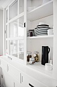 Black and white crockery in an open dresser