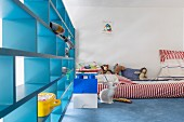 Blue partition shelving in cheerful, colourful child's bedroom
