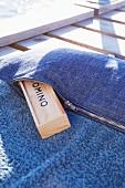 Beach towel with sewn-on denim pocket