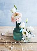 Pink ranunculus in blue vase