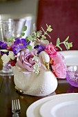 Romantic bouquet in swan-shaped vase