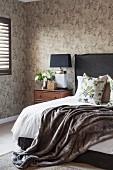 Masculine bedroom with dark grey accents