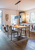 Dining area in kitchen with dog looking out of open door