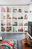 Collection of vintage objets d'art in masonry shelving compartments