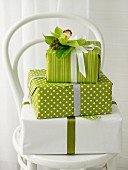 Stacked gifts in green and white with floral decoration