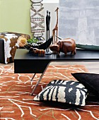 Patterned rug in living room decorated in African style