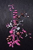 Tree-shaped arrangement of twigs and nuts painted pink and silver