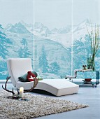 Modern lounger in front of wallpaper mural of mountains