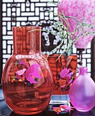 Red glass vases with fish motifs and pink vase