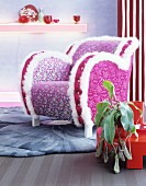Flamboyant, pink floral armchair with white fluffy trim