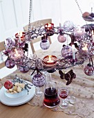 Tealights on festively decorated, suspended metal wreath