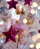 Barbie doll amongst silver and pink Christmas tree decorations