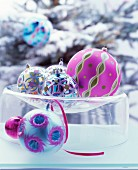 Ornate Christmas baubles in glass dish