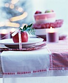 Decorative Advent place setting on red and white checked tablecloth