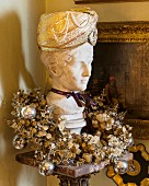 Bust of woman wearing Oriental hat and festive wreath